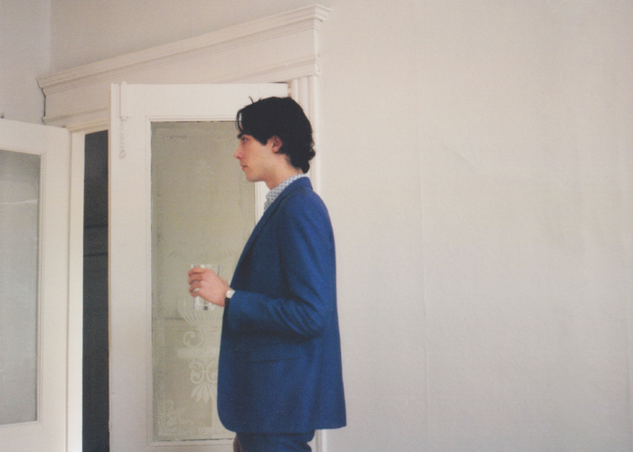 Suit by Acne, shirt by Fred Perry